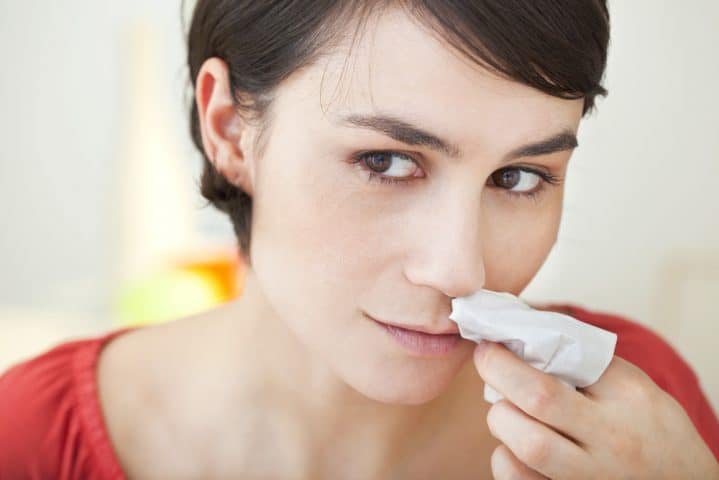 woman with nosebleed bloody nose bay area treatment